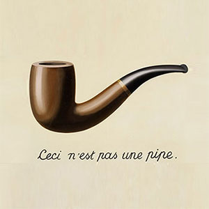 Old pipe illustration with 'This is not a pipe' caption in french